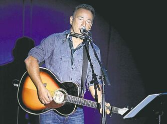 Singer/songwriter Bruce Springsteen performs at a campaign event for President Barack Obama, Thursday, Oct. 18, 2012, in Parma, Ohio. (AP Photo/Tony Dejak)