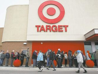 Hundreds of shoppers wait for the opening of the new Target store in Guelph, Ont., last month.