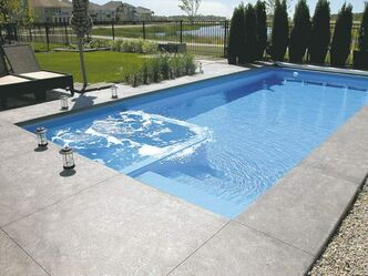 Aqua Tech had gold-medal winners at the Pool and Hot Tub Council's 2012 Design and Construction Awards with this rectangular pool in the Vinyl Swimming Pool and Hot Tub Combination category and with the guitar-shaped pool below.