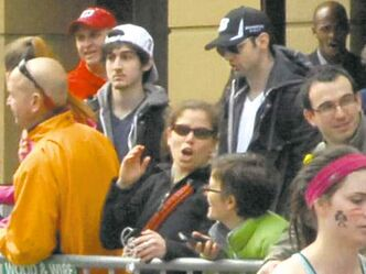 A spectator's photo shows the bombing suspects in a crowd prior to the attack.