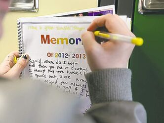 Grade 8 Windsor School students spend the final moments on the last day of school writing in each others yearbooks, cleaning out lockers and sharing tearful goodbyes as they transition from middle years school to high school.