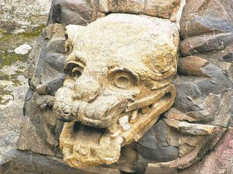 Menacing stone carvings adorn the outside of the Pyramid of the Feathered Serpent at Teotihuacan near Mexico City.