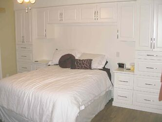 The master bedroom includes built-in cabinetry by Pete Wall of Morden behind the king-size bed.