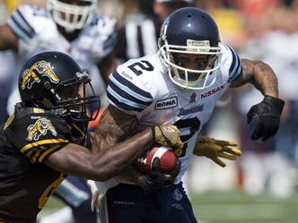 Toronto Argonauts wide receiver Chad Owens (right) is leading the CFL in receiving with 1,025 yards on 73 catches and in combined yards with 2,915.