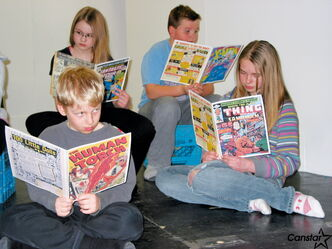 The cast members of Adventures of a Comic Book Artist rehearse for their upcoming performances.
