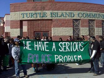 A rally at the Turtle Island Recreation Centre kicked off a walk to protest police violence.