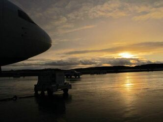 First Air 767 basks in sunset's glow on tarmac of Iqaluit airport shortly after arrival with 90,000 pounds of freight.