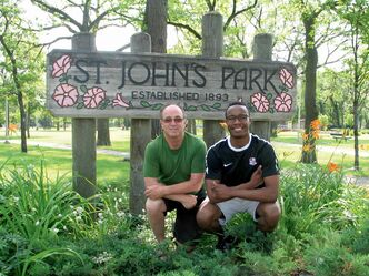 North End Community Renewal Corporation  (NECRC) communications and events co-ordinator Martin Landy (left) and Picnic in the Park co-ordinator Anthony Sannie in St. John's Park.