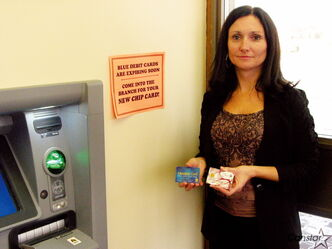 Adeline Richardson shows the La Salle Credit Union's  old and new debit cards.