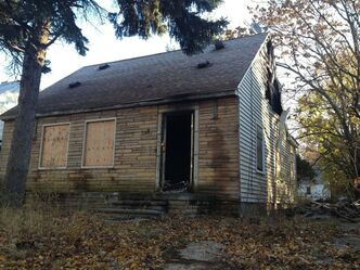 "This Thursday, Nov. 7, 2013 photo shows the fire damaged childhood home of rapper Eminem in Detroit. Fire crews responded Thursday evening to the boarded-up bungalow, which is pictured on the cover of Eminem's just-released ""The Marshall Mathers LP 2."" It also was on the musician's 2000 album ""The Marshall Mathers LP."" The blaze damaged portions of the small home's top floor. The cause of the fire wasn't immediately known. (AP Photo/Detroit Free Press, Tammy Stables Battaglia) DETROIT NEWS OUT; NO SALES"
