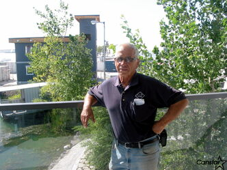 Mario Costantini displays his new office building and pond on his property at 3000 McGillivray Bouvelard.