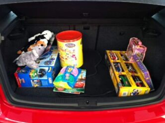 St. James Volkswagen/Audi's Fill Our Trunk campaign for the Christmas Cheer Board gets its first donation.