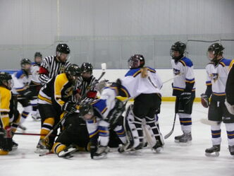 A brawl at a minor hockey game in Stonewall earlier this year resulted in criminal charges against two teenage players.