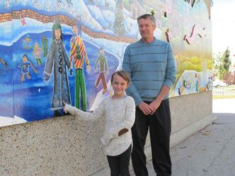Whyte Ridge Elementary School student Ava Peters and her principal Dave Poersch outside Whyte Ridge Elementary School, where the school's brand-new mural was unveiled Sept. 30 during an outdoor assembly.