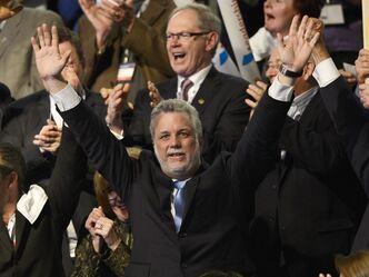 Quebec Liberal Party leadership candidate Philippe Couillard salutes supporters after the results are announced from the first ballot vote at the party's convention Sunday, March 17, 2013 in Montreal. Couillard has been elected by party members on the first ballot. THE CANADIAN PRESS/Ryan Remiorz