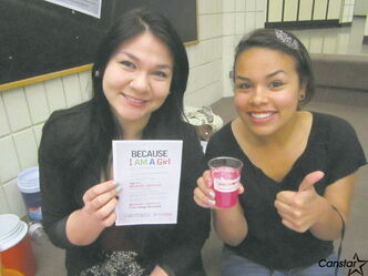RETSD lighthouse staff Breanne Lavalee-Heckert (left) and Kayla Lawson during a pink lemonade sale at Valley Gardens Middle School.
