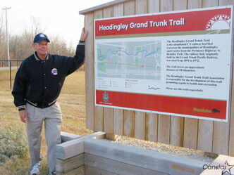 Member of the Headingley Grand Trunk Trail Association Ray Hutton stands next to one of the trail's kiosks.