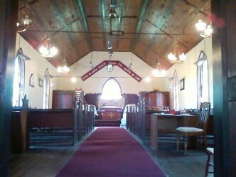 The interior of St. Anne's Anglican Church at Poplar Point has been carefully preserved to reflect its 155-year history.