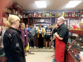 Tourists visit Mordens' of Winnipeg Candy Manufacturing Ltd. (674 Sargent Ave.).