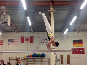 Davey Boschmann in action on the parallel bars.