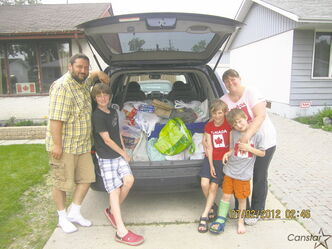 The Houston family and their van loaded with the food collected at this year's Canada Day fireworks party for Winnipeg Harvest.