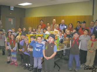 Students from the Beavers and Cubs filled a table with donated gifts at the Fire Station No. 18 at 5000 Roblin Blvd.
