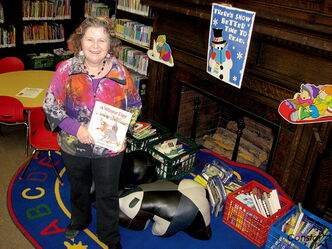 Winnipeg Library Foundation chair Sandy Hyman stands by the vintage fireplace in storied St. John's LIbrary, which is on tap to receive significant upgrades ahead of its centennial in 2015.