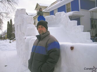 David Neyedli and the magnificent snow castle he built outside his house on Home Street.