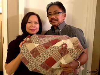 Mario Rosario, AIM president, and his wife Myra Rosario with an example of the care mission hampers the organization takes to the Philippines each year.