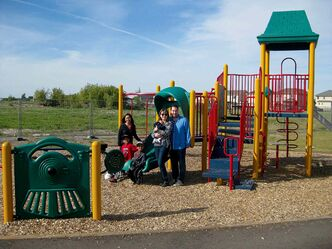 From left, Rowena Sarran, Nicklas Sarran, Joshua Sarran, Lorianne Kowaliszyn, Everett Kowaliszyn and Tim Kowaliszyn enjoy Phase 1 of the Amber Trails community park.
