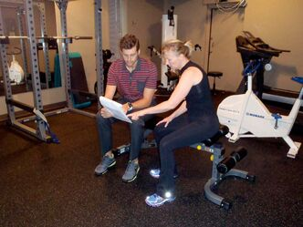 Wellness consultant Gavin McHale goes over a lifestyle plan with client Carolin Burke inside the fitness centre at Ness Physiotherapy.