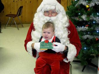 Five-month-old Addison wasn't sure what to make of Santa when they met at Winakwa Community Centre in Windsor Park.