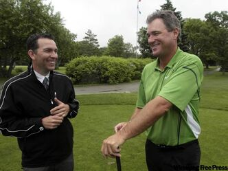 Brian Mogg (right) and Rob McMillan, executive chairman of the Players Cup, share a laugh on the first tee at Pine Ridge Golf Club.
