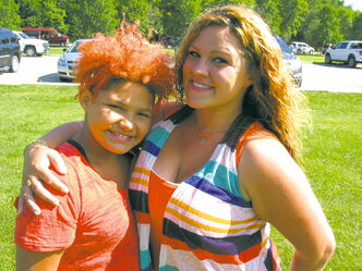 Hannah (left) and her mom, Cori, at St. Vital Park on July 19, to celebrate the presentation of a jeep to Cori's son, Iasiah, who has leukemia, from The Dream Factory.