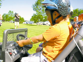 Isaiah, 3, and Xavier, 4, enjoy a drive at St. Vital Park on July 19 in Isaiah's new jeep, which was presented by The Dream Factory.