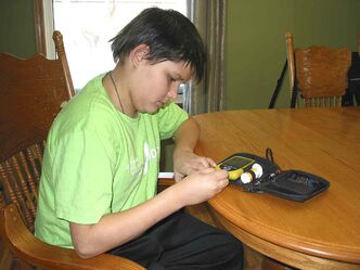 Windsor Park resident Remillard, 13, has to monitor his intake of carbohydrates and adjust his insulin to control his diabetes.