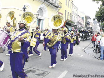 Music and parades (this one in honour of the Sugar Bowl) are a big part of New Orleans' appeal.
