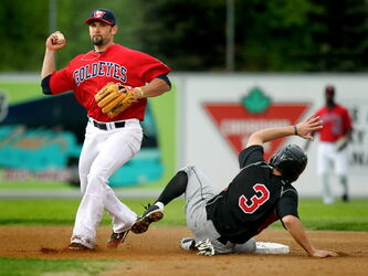 Winnipeg Goldeyes' Jake Blackwood, seen tagging out Sioux City Explorers' Michael Lang at second, is hoping to add a third league title to his resumé while in Winnipeg.