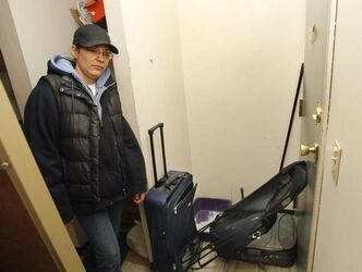 Erin Tilling barricades her door, at 375 Assiniboine Ave., with suitcases and a folding chair before going to bed at night.