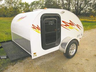 The front of the trailer has an expanded metal deck to transport camping essentials, such as a cooler and a barbecue.