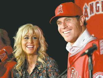 Josh Hamilton and his wife Katie said Saturday at a L.A. news conference he was, in effect, stood up by the Rangers.