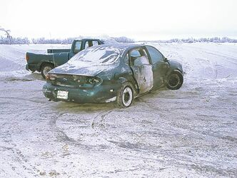 This Ford Taurus would only drive in reverse after countless laps around the track and numerous  collisions.