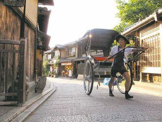 A man pulls a rickshaw-for-hire down a narrow street in Kyoto near the city's Kiyomizu Temple. The temple and surrounding neighborhood are a great place to explore for families with children, who'll find shops along the way giving away sample sweets.
