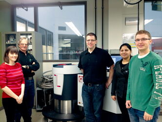 Dr. Chris Wiebe (centre) is shown in his University of Winnipeg lab with some of his students.