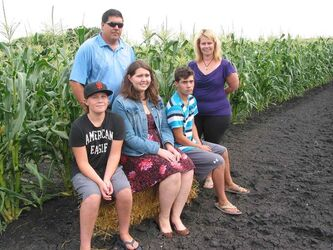 (Back row, left) Kon and Julie Paseschnikoff and their children (front row, left) Gregori, Katarina and Daniel run a market garden, apiary and homemade jam and jelly business from their home in the RM of Macdonald.