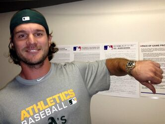 Oakland Athletics catcher John Jaso, a former Seattle Mariners catcher, poses for a photo with his new Rolex watch, a thank you gift from Mariners' Felix Hernandez for catching his perfect game in August, on Monday, April 1, 2013, in Oakland, Calif. A clubhouse employee delivered the gold watch from Seattle's side to the Oakland clubhouse for Jaso about 90 minutes before first pitch in the Mariners-Athletics season opener baseball game Monday night. (AP Photo/Janie McCauley)