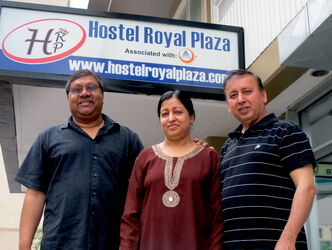 Suroj (centre) and Ashwani Nagpal (right), owners of the Hostel Royal Plaza with their construction manager Manny Singh (left) outside their new establishment at 330 Kennedy St. in downtown Winnipeg. The Nagpals want their hostel to be a home away from home for international students.