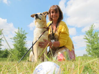 Christine Boult, director of development at the Winnipeg Humane Society, with Moose an adoptable eight-year-old Shepard-mix. Boult said though the In the Ruff is sold out for this year, golfers are encouraged to register as soon as possible for next year.