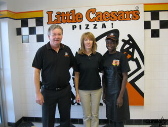 Richard and Jackie Dean, owners of Little Caesar Pizza along with employee Yetunde (Yettie) Adewumi.
