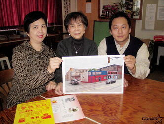 From left: Chinese Dramatic Society member Maria Lip and president Natalia Wong, and Joe Chan, assistant to Coun. Harvey Smith, hold up a photo of the buiding at 219 Logan Ave. they hope will soon be transformed into a new, permanent base of operations for the society's activities.